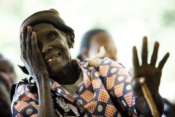 """Terick Mogaddona (85 yrs) struggled to read the """"E"""" vision chart during the first stage of the screening process at the surgical eye camp at the Mogil sub-district hospital."""