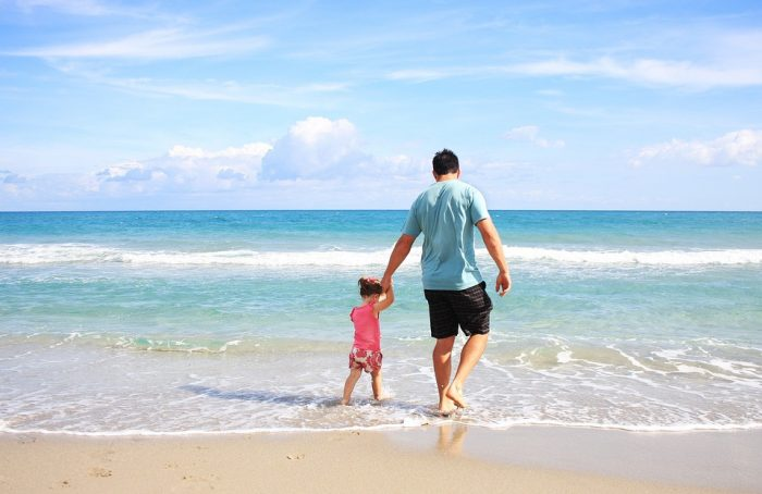 Dad on beach with daughter