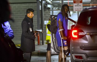 Nic Naitanui arrives back in Perth after injuring his knee in Melbourne.Picture: Ross Swanborough