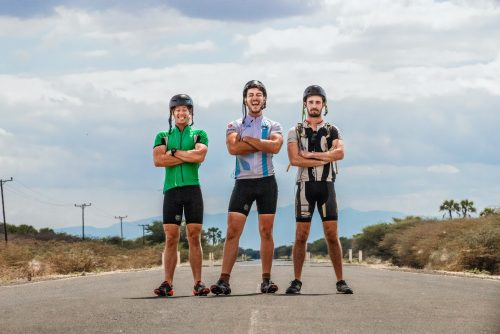 the pedal it forward boys pose on an african road