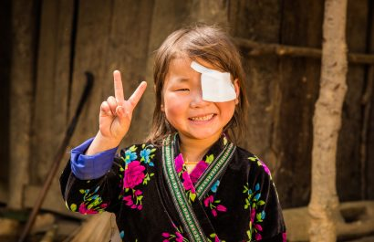 7 year old vietnamese girl poses for photo after receiving cataract surgery from CBM australia for miracles day in vietnam