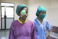 Najim (16) from India walking out of cataract surgery.