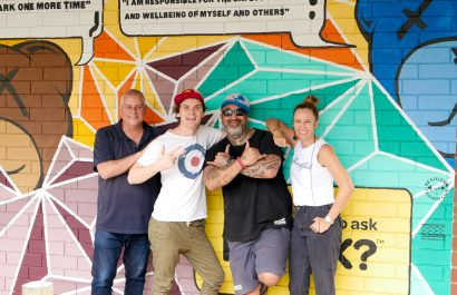 The Brekky Team with Gracey in front of one of his Art Vs Depression murals.